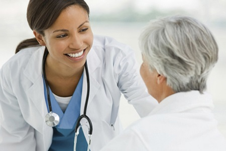 Woman with stethoscope helping patient