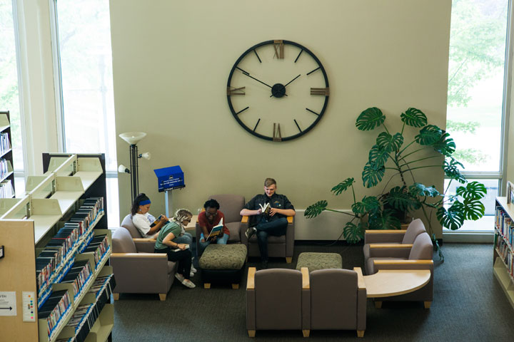 Students sitting in a reading area in the Library