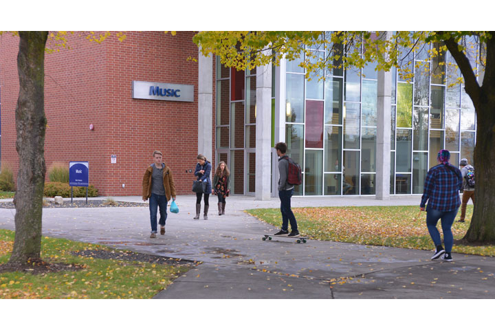 Students walking in area outside of Music Building