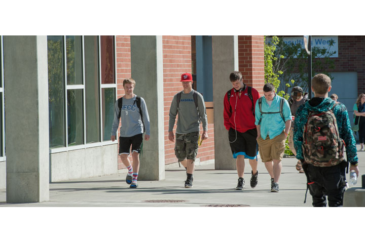 Five students walking outside of Music Building