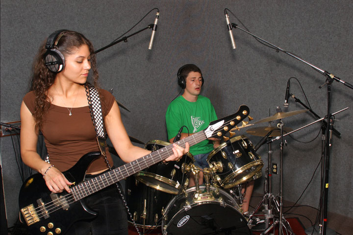 Student musicians practicing on bass and drums