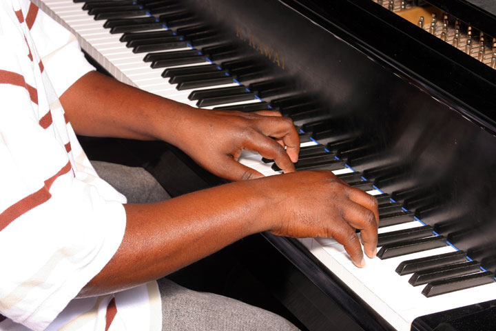 Student musician practicing keyboard