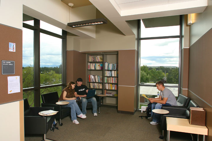 Three students sitting in study area on upper level