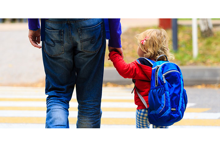 Parent walking with child on campus