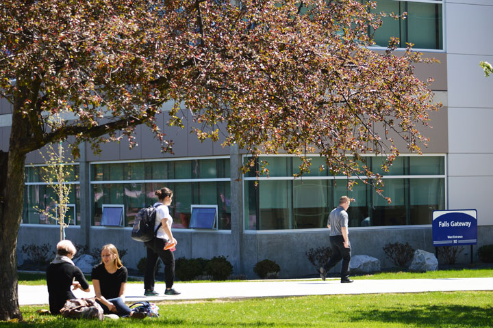 Students outside of the west entrance of Building 30