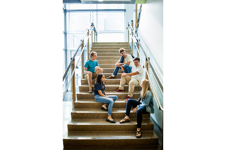Five students on stairway in Building 30