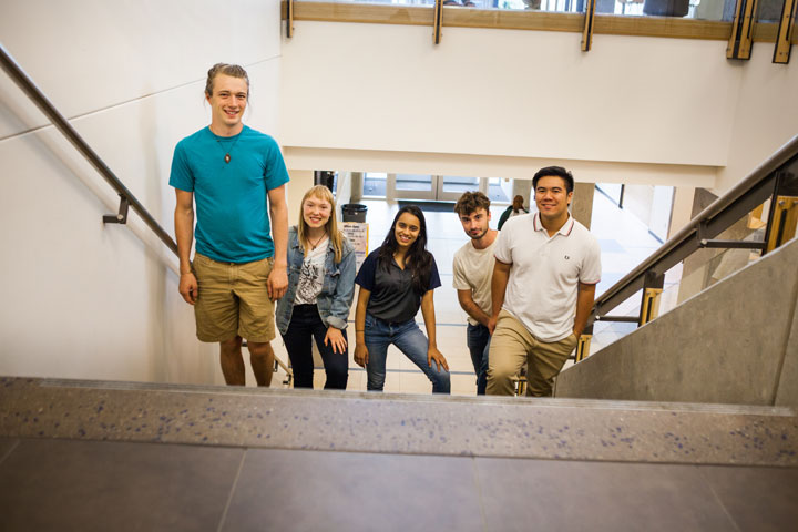 Five students going to upper level in Building 30