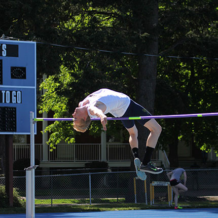 Man clearing a high jump