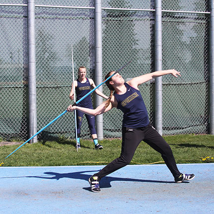 Women throwing a javelin