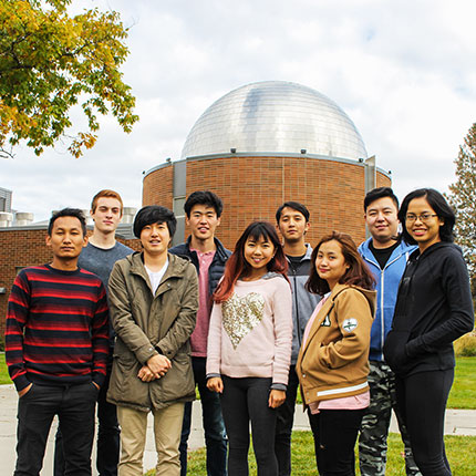 Group of students outside in front of the SFCC planetarium