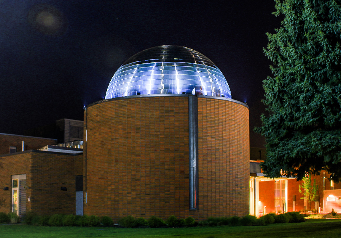 Outdoor image of the planetarium at night