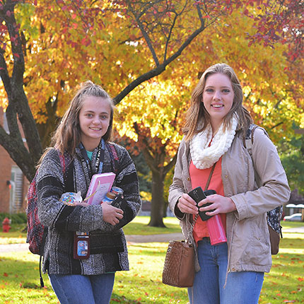 SFCC Students smiling under fall colors