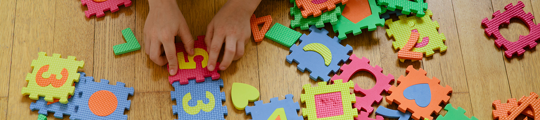 Child playing with foam letters