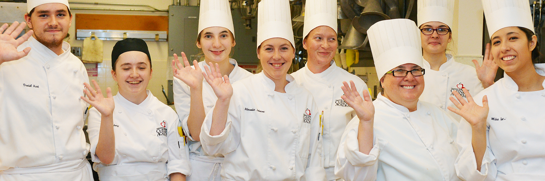 Culinary students smiling and waving