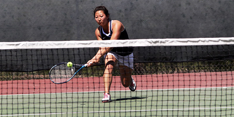 Women Tennis player returning the ball