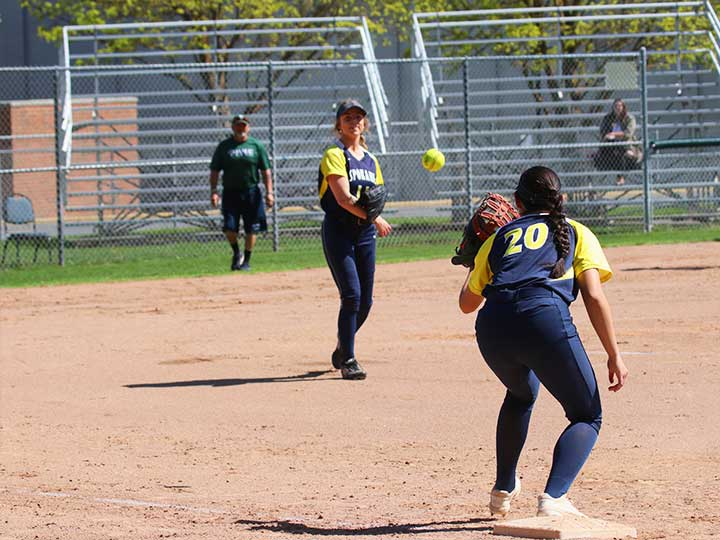 Softball players passing the ball