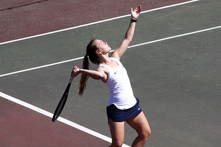 Female Tennis player serving the ball