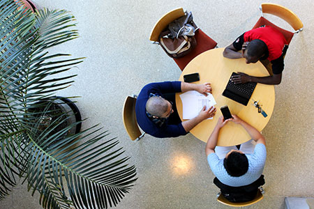 Group studying at table from above