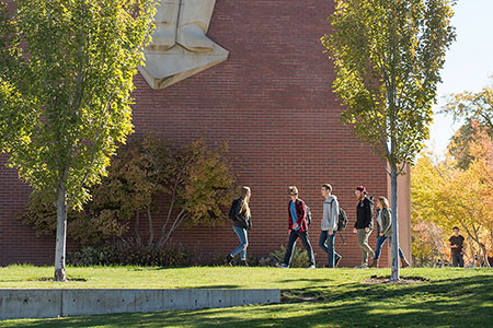 Photo of students walking in front of WSU library exterior.