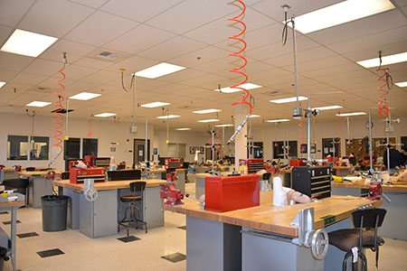 O&P lab full of individual workstations with tool sets and equipment